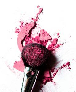 Crushed pink eyeshadow and make-up brush